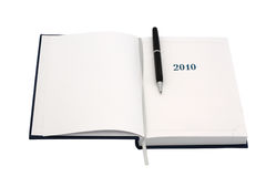 Organizer for 2010. With black pen. Isolated object Royalty Free Stock Photo