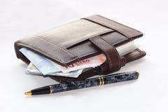Organizer. A Filofax with a pen and money Stock Photo