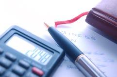 Organizer, calculator, fountain pen Royalty Free Stock Image