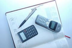 Organizer, calculator, fountain pen Royalty Free Stock Images