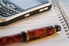 organizer with cell phone Royalty Free Stock Photo