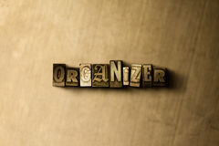 ORGANIZER - close-up of grungy vintage typeset word on metal backdrop Royalty Free Stock Photos