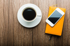 Organizer with cup of coffee and mobile phone Stock Image
