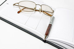 Organizer, glasses and pen Royalty Free Stock Photography