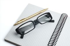 Organizer, glasses and pen Stock Photo