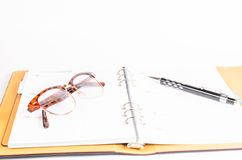 Organizer with Glasses on wooden table Stock Photography