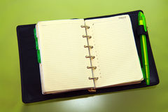 Organizer with green pen Royalty Free Stock Image