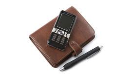 Organizer and mobile phone isolated Royalty Free Stock Image