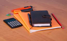 Organizer, notebook, pen, pencil, marker, cutter and calculator on desktop. Royalty Free Stock Images