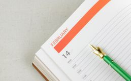 Organizer open on the Valentine's day date Royalty Free Stock Image