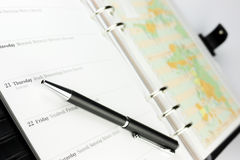 Organizer and pen Royalty Free Stock Photos