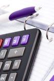 Organizer, pen and calculator Stock Photo