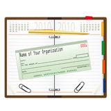 Organizer with pen and cheque Stock Photos