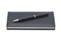 Organizer with pen. White background. Stock Images