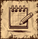 Organizer and pencil on vintage background Royalty Free Stock Images