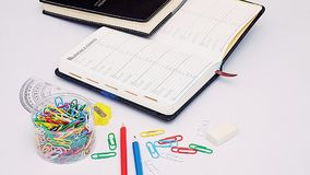 Organizer and stationery on working desk. Organizer and stationery on a white working desk Royalty Free Stock Image
