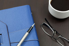 Organizer on table. With pen and glasses Royalty Free Stock Image