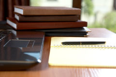 Organizers the laptop and pen on a desk stock images