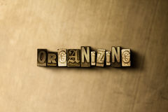 ORGANIZING - close-up of grungy vintage typeset word on metal backdrop. Royalty free stock illustration.  Can be used for online banner ads and direct mail Stock Images