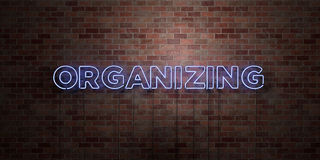 ORGANIZING - fluorescent Neon tube Sign on brickwork - Front view - 3D rendered royalty free stock picture. Can be used for online banner ads and direct Stock Photography