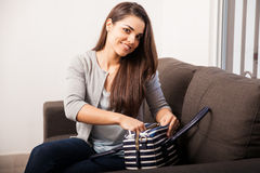 Organizing her purse Royalty Free Stock Photography