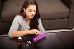 Organizing her vitamins Stock Images