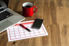 Organizing monthly activities in the calendar Royalty Free Stock Photo