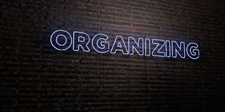 ORGANIZING -Realistic Neon Sign on Brick Wall background - 3D rendered royalty free stock image. Can be used for online banner ads and direct mailers Stock Image