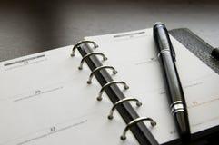 Organizzatore con una penna Fotografia Stock