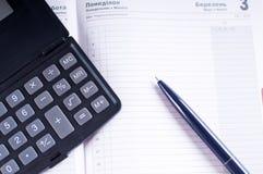 Organizzatore e penna Immagine Stock