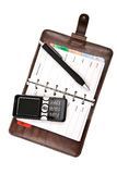 Organizzatore e telefono mobile isolati Fotografie Stock