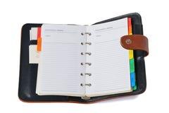 Organizzatore - pianificatore settimanale sopra bianco Fotografia Stock
