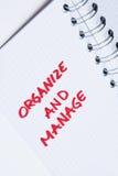 Organizzi e gestisca - la nota del taccuino Immagini Stock