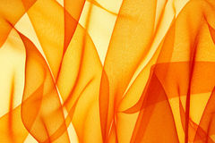 Organza. Background from a fabric with folds, illumination behind Stock Photo