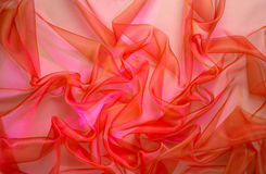 Organza #2. Background from a fabric with folds, highlighted sideways Stock Image