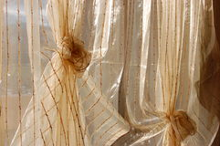 Organza curtain. Sunlight shining through transparent organza curtain Royalty Free Stock Images