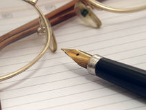Orgaynizer, glasses and pen Stock Photo