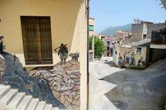 ORGOSOLO, ITALIË - MEI 21, 2014: Muurschilderijen Stock Foto