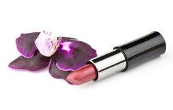 Orhid flower and lipstick Stock Images