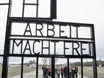 Entrance gate of the Sachsenhausen Concentration camp. The door stock photography