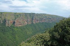 Oribi Gorge canyon with rugged cliffs. View of green foliage and rugged steep cliffs of the Oribi Gorge canyon in Kwazulu Natal Stock Photography