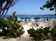 Orient beach. View of path to beach in St. Martin with umbrellas and beach chairs Stock Photo