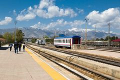 Orient Express in Erzurum. ERZURUM, TURKEY - MAY 06, 2017 : Wagon view of Orient Express train on railroad on cloudy sky background. It is famous train service Royalty Free Stock Photography