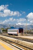 Orient Express in Erzurum. ERZURUM, TURKEY - MAY 06, 2017 : Wagon view of Orient Express train on railroad on cloudy sky background. It is famous train service Stock Image