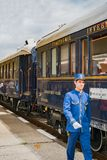 The legendary Venice Simplon Orient Express. Ruse city, Bulgaria - August 29, 2017. The butler. The legendary Venice Simplon Orient Express is ready to depart stock images