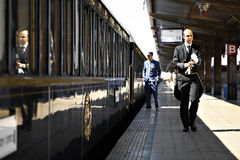 Orient Express train. Bucharest, Romania - September 3, 2012: A man in uniform walks by the Orient Express train, shortly after arriving in Bucharest. The Venice stock photos