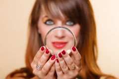 Orient girl with makeup showing armlet. Closeup young orient eastern girl with makeup. Woman showing jewelry fashionable accessories bijouterie armlet. Manicure Royalty Free Stock Photos
