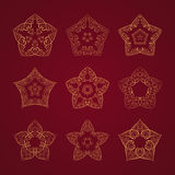 Orient star set. Vector set of nine ornamented orient stars on red background Royalty Free Stock Photos