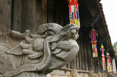 Orient symbol of dragon in a pagoda Royalty Free Stock Photos