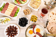 Orient table full of breakfast components. Arabian food with delicious traditional oriental breakfast ingredients in high angle view Royalty Free Stock Photo